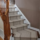 What are the pros of utilizing carpets on stairs?